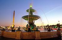 France, Paris, Place de la Concorde, fountain illuminated  at dusk
