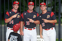 Batavia Muckdogs Chad Smith (34), Brent Wheatley (30), and Mike King (22) during an autograph signing before a game against the West Virginia Black Bears on August 20, 2016 at Dwyer Stadium in Batavia, New York.  Batavia defeated West Virginia 7-2. (Mike Janes/Four Seam Images)