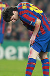Barcelona's Lionel Messi looks on his wounds during Champions League match. March 17, 2010. (ALTERPHOTOS/Tati Quinones)