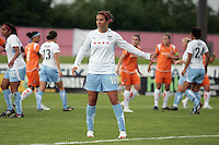 Chicago's Carli Lloyd (10) gestures as she and her teammates prepare to defend a free kick by Sky Blue.  Sky Blue defeated the Chicago Red Stars 1-0 in a mid-week game, Wednesday, June 17, at Yurcak Field.