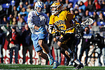 Face-Off Classic: Attackman Rob Grimm #5 of the UMBC Retrievers attempts to make a move on Midfielder John Ranagan #31 Hopkins during the UMBC v Johns Hopkins mens lacrosse game at M&T Bank Stadium on March 10, 2012 in Baltimore, Maryland.(Ryan Lasek/ Eclipse Sportswire)