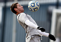 WASHINGTON, DC - NOVEMBER 25, 2012: Tyler Rudy (13) of Georgetown University pulls down a high ball against Syracuse University during an NCAA championship third round match at North Kehoe field, in Georgetown, Washington DC on November 25. Georgetown won 2-1 after overtime and penalty kicks.