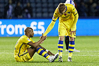 Jay Fulton of Swansea City (R) helps team mate Andre Ayew of Swansea City up after the end of the game during the Sky Bet Championship match between Sheffield Wednesday and Swansea City at Hillsborough Stadium, Sheffield, England, UK. Saturday 09 November 2019