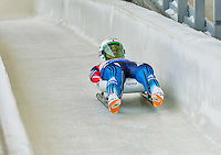 5 December 2014: Alexandr Peretjagin, sliding for Russia, crosses the finish line on his first run, ending the day with a 5th place finish and a combined 2-run time of 1:43.217 in the Men's Competition at the Viessmann Luge World Cup, at the Olympic Sports Track in Lake Placid, New York, USA. Mandatory Credit: Ed Wolfstein Photo *** RAW (NEF) Image File Available ***