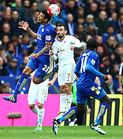 Leonardo Ulloa of Leicester City wins a header against Leon Britton of Swansea City during the Barclays Premier League match between Leicester City and Swansea City played at The King Power Stadium, Leicester on 24th April 2016
