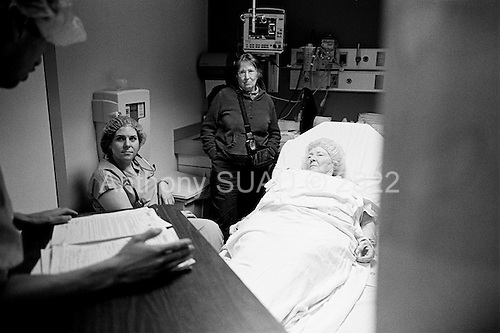 Chicago, Illinois<br /> USA<br /> December 17, 2009<br /> <br /> At the University of Chicago Medical Center Geraldine Martin, 80 years old, is prepared for open heart surgery to have a valve replaced and hole repaired. She is accompanied by her sister Helen Martin prior to the surgery. A head nurse gives her some practical advice and warns her of her complications.