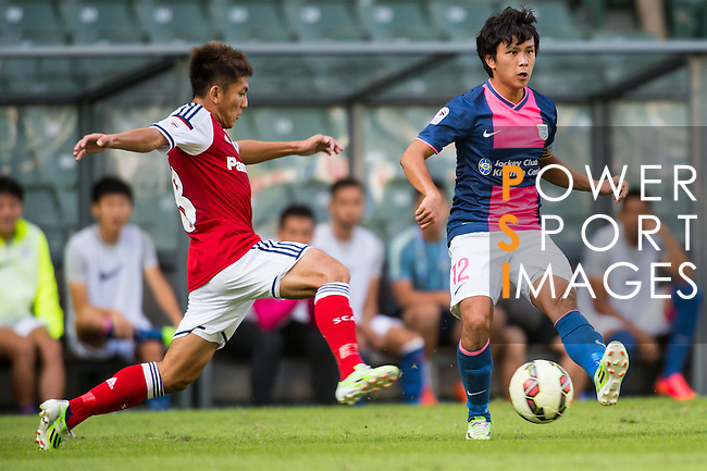Kin Fing Cheung of Kitchee (R) being followed by Jorge Tarres of Kitchee (L) during the HKFA Premier League between South China Athletic Association vs Kitchee at the Hong Kong Stadium on 23 November 2014 in Hong Kong, China. Photo by Aitor Alcalde / Power Sport Images