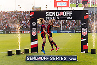 EAST HARTFORD, CT - JULY 5: Samantha Mewis #3 and Kristie Mewis #6 of the United States chest bump during post-game ceremonies after a game between Mexico and USWNT at Rentschler Field on July 5, 2021 in East Hartford, Connecticut.