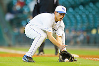 First baseman Luke Maile #21 of the Kentucky Wildcats fields a ground ball against the Houston Cougars at Minute Maid Park on March 5, 2011 in Houston, Texas.  Photo by Brian Westerholt / Four Seam Images