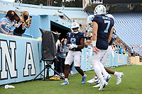 CHAPEL HILL, NC - OCTOBER 10: Michael Carter #8 celebrates his 16-yard touchdown run with teammate Sam Howell #7 during a game between Virginia Tech and North Carolina at Kenan Memorial Stadium on October 10, 2020 in Chapel Hill, North Carolina.