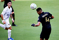 LOS ANGELES, CA - AUGUST 22: Eddie Segura #4of the LAFC heads a ball during a game between Los Angeles Galaxy and Los Angeles FC at Banc of California Stadium on August 22, 2020 in Los Angeles, California.