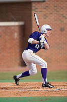 Cody Manzella (13) of the High Point Panthers follows through on his swing against the UNCG Spartans at Willard Stadium on February 14, 2015 in High Point, North Carolina.  The Panthers defeated the Spartans 12-2.  (Brian Westerholt/Four Seam Images)