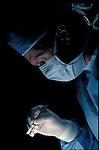 Surgeon holding scalpel