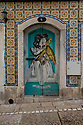 A door with a picture of a girl with a flying fish painted on it, Sesimbra, Portugal.