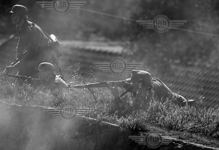 Reenactor playing the part of attacking German troops 1940. <br /> <br /> Airplanes and reenactors photographed at in connection with Høytorptreffet, an annual event at the Høytorp fort. <br /> <br /> Høytorp fort is a barrage fort in the Glomma defence line, built 1912-17. On April 13th and 14th 1940 the fort was in combat against German army units . It is now protected as a national monument.<br /> <br /> ©Fredrik Naumann/Felix Features