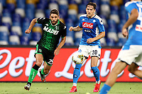 Domenico Berardi of US Sassuolo and Piotr Zielinski of SSC Napoli compete for the ball during the Serie A football match between SSC Napoli and US Sassuolo at stadio San Paolo in Napoli ( Italy ), July 25th, 2020. Play resumes behind closed doors following the outbreak of the coronavirus disease. <br /> Photo Cesare Purini / Insidefoto