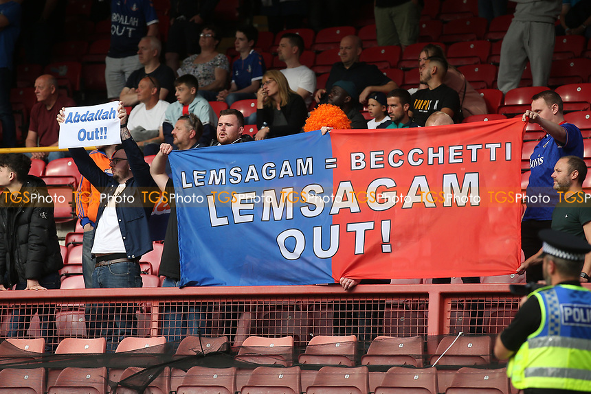 Oldham fans protest with a 'Lemsagam = Becchetti' banner during Leyton Orient vs Oldham Athletic, Sky Bet EFL League 2 Football at The Breyer Group Stadium on 11th September 2021