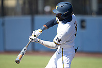 Michigan Wolverines outfielder Christian Bullock (5) swings the bat during the NCAA baseball game against the Illinois Fighting Illini on March 20, 2021 at Fisher Stadium in Ann Arbor, Michigan. Michigan won the game 8-1. (Andrew Woolley/Four Seam Images)