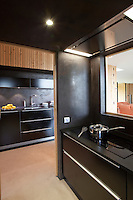 The signature black kitchen occupies a central position in the open plan living/dining area