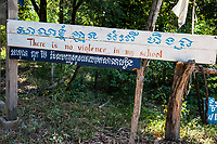 "Cambodia.  ""No violence in my school"" Sign at School Entrance.  Sign in Khmer and Roman Alphabets."
