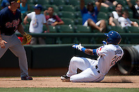 Round Rock Express outfielder Julio Borbon #20 slides into third base during the Pacific Coast League baseball game against the Memphis Redbirds on May 6, 2012 at The Dell Diamond in Round Rock, Texas. The Express defeated the Redbirds 5-1. (Andrew Woolley/Four Seam Images)
