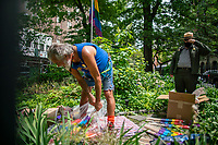 NEW YORK, NY - JUNE 1 : A man organizes gay flags at Gay Liberation Monument on June 1, 2021. in New York City. New York City's Pride events organizers banned police and other law enforcement from marching during annual parade until 2025. (Photo by Eduardo MunozAlvarez/VIEWpress)