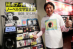 A Japanese fan poses for a photograph in front of a special section of Bob Dylan's music on display at Tower Records Shibuya on October 14, 2016, Tokyo, Japan. Bob Dylan (75) won the 2016 Nobel Prize in Literature for ''having created new poetic expressions within the great American song tradition,'' as announced by the Swedish Academy. Dylan is the first singer-songwriter to receive this award. (Photo by Rodrigo Reyes Marin/AFLO)