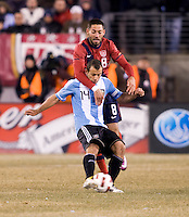 Javier Mascherano, Clint Dempsey. The USMNT tied Argentina, 1-1, at the New Meadowlands Stadium in East Rutherford, NJ.