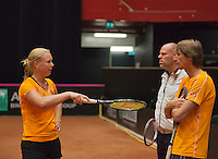 The Netherlands, Den Bosch, 16.04.2014. Fed Cup Netherlands-Japan, captain Paul Haarhuis (NED) (R) and coach Raymond Knaap (NED)in discussion with Kiki Bertens (NED)<br /> Photo:Tennisimages/Henk Koster