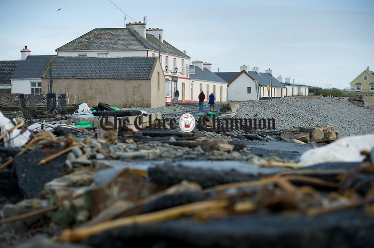 The rubble strewn road  in Kilbaha village which is covered by rocks, undermined in places and cut off following the latest high seas and gales at Kilbaha. Photograph by John Kelly.