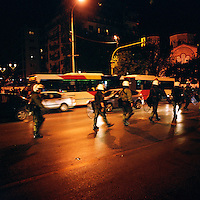 Police in full riot gear approaching a student demonstration during the financial crisis.