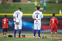 A couple of young baseball players join Winston-Salem Dash shortstop Yeyson Yrizarri (2) and second baseman Mitch Roman (4) for the National Anthem prior to the game against the Buies Creek Astros at BB&T Ballpark on May 5, 2018 in Winston-Salem, North Carolina. The Dash defeated the Astros 6-2. (Brian Westerholt/Four Seam Images)