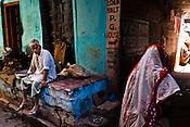 A vendor sits outside his house in the ancient city of Varanasi in Uttar Pradesh, India. Photograph: Sanjit Das/Panos
