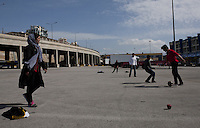 Pictured: Children play football at the port car park Monday 07 March 2016<br /> Re: Migrants have been gathering at the port of Piraeus, near Athens, Greece.