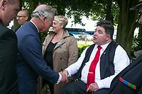 Son Altesse Royale le prince de Galles serre la main de l'honorable Kent Hehr, ministre des Anciens Combattants et ministre associé de la Défense nationale, à son arrivée à la cérémonie soulignant le 100e anniversaire de la bataille de Beaumont-Hamel.<br /> <br /> Photo : Julien Faure
