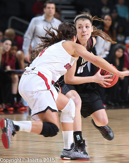 SIOUX FALLS, SD - MARCH 9: Caitlyn Tolen #12 of IUPUI drives against defender Tia Hemiller #4 of USDin the first half of their semi-final round Summit League Championship Tournament game Monday afternoon at the Denny Sanford Premier Center in Sioux Falls, SD. (Photo by Richard Carlson/Inertia)