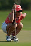 CHON BURI, THAILAND - FEBRUARY 20:  Michelle Wie of USA lines up a put on the 17th green during day four of the LPGA Thailand at Siam Country Club on February 20, 2011 in Chon Buri, Thailand. Photo by Victor Fraile / The Power of Sport Images