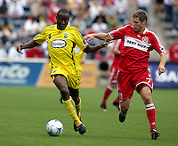 Columbus Crew midfielder Emmaneul Ekpo (17) dribbles the ball while being defended by Chicago Fire midfielder Logan Pause (7).  The Columbus Crew tied the Chicago Fire 2-2 at Toyota Park in Bridgeview, IL on September 20, 2009.