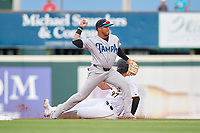 Tampa Tarpons third baseman Roberto Chirinos (14) turns a double play in the shift as Abrahan Gutierrez (27) slides in during Game One of the Low-A Southeast Championship Series against the Bradenton Marauders on September 21, 2021 at LECOM Park in Bradenton, Florida.  (Mike Janes/Four Seam Images)