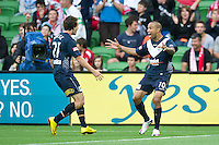 MELBOURNE, AUSTRALIA - DECEMBER 11: Archie Thompson reacts to Robbie Kruse's goal ball during the round 18 A-League match between the Melbourne Heart and Melbourne Victory at AAMI Park on December 11, 2010 in Melbourne, Australia. (Photo by Sydney Low / Asterisk Images)