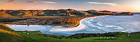 Sunrise over Wickliffe Bay on Otagao Peninsula. Victory Beach and Papanui Inlet in centre, Otago, East Coast, New Zealand