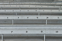 Old fashioned bleacher seats at a baseball park.