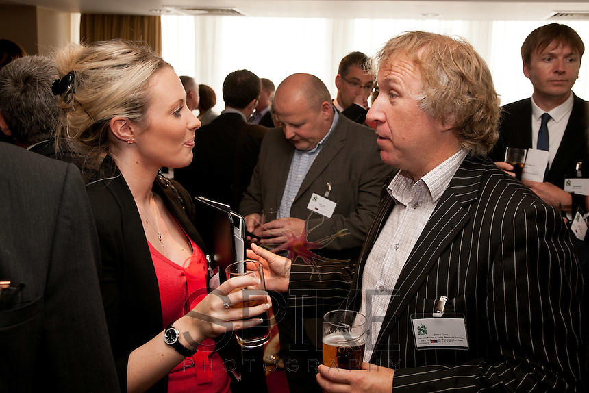 In the middle of a chat are Emily Revill of Calverton Finance and Simon Clark of Notts County Financial Services
