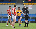 Keelan Sexton of Clare  is shown a yellow card by referee Niall Ward during their National Football League game at Cusack Park. Photograph by John Kelly.