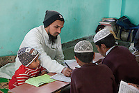Imam Approving the Work of Madrasa Students, Madrasa Imdadul Uloom, Dehradun, India.