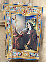 A tapestry depicting Italian Camilla Battista da Varano hangs on the facade of Saint Peter's Basilica during a canonization mass in St. Peter's square, Vatican, 17 October 2010. The pope formally recognized Australia's first saint, Sister Mary MacKillop, who is revered as a pioneer of education in Outback Australia and the founder of the Sisters of St Joseph of the Sacred Heart. She was canonised along with Stanislaw Soltys of Poland, Andre Bessette of Canada, Candida Maria de Jesus Cipitria y Barriola of Spain, and Italians Giulia Salzano and Battista da Varano.