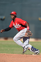 Cincinnati Reds shortstop Cory Thompson (15) during an Instructional League game against the Kansas City Royals on October 14, 2014 at Goodyear Training Complex in Goodyear, Arizona.  (Mike Janes/Four Seam Images)