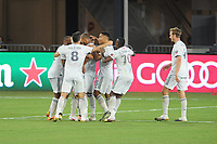 WASHINGTON, DC - AUGUST 25: Teal Bunbury #10 of New England Revolution celebrates his score with teammates during a game between New England Revolution and D.C. United at Audi Field on August 25, 2020 in Washington, DC.