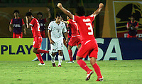 The United States' Danny Cruz (5) walks off the field between celebrating South Korea players at the end of the FIFA Under 20 World Cup Group C match between the United States and South Korea at the Mubarak Stadium on October 02, 2009 in Suez, Egypt. The US team lost 3-0.