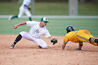 Jesus Pacheco (2) during the WWBA World Championship at the Roger Dean Complex on October 10, 2019 in Jupiter, Florida.  Jesus Pacheco attends Cypress Bay High School in Weston, FL and is committed to Jacksonville.  Colby Halter  (7) slides in.  (Mike Janes/Four Seam Images)